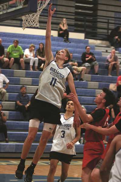 PMG PHOTO: PHIL HAWKINS - Incoming 6-foot-4 senior post David Cherimnov is one of few Woodburn players coming back to the program with size next year.