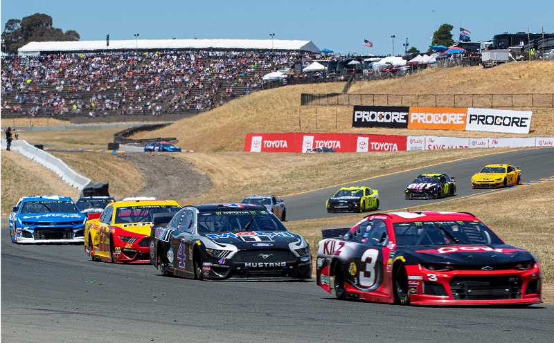 LON AUSTIN/CENTRAL OREGONIAN - Austin Dillon leads Kevin Harvick, Joey Logano and a string of cars though the S curves at Sonoma International Raceway on Sunday during the NASCAR Toyota/Save Mart 350.