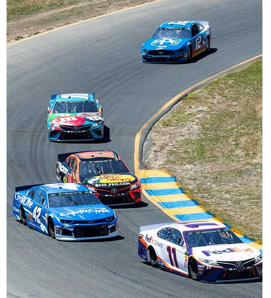 LON AUSTIN/CENTRAL OREGONIAN - Denny Hamlin leads Kyle Larson, Martin Truex Jr., Kyle Busch and Ryan Blaney into the Carousel at Sonoma International Raceway. Hamlin won the second stage of Sunday's race, while Truex won the race and Busch was second.