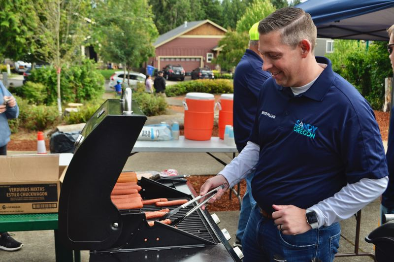 PMG PHOTO: BRITTANY ALLEN - Mayor Stan Pulliam grills up hotdogs for the masses at June 20 Longest Day Parkway in Timberline Ridge Park.
