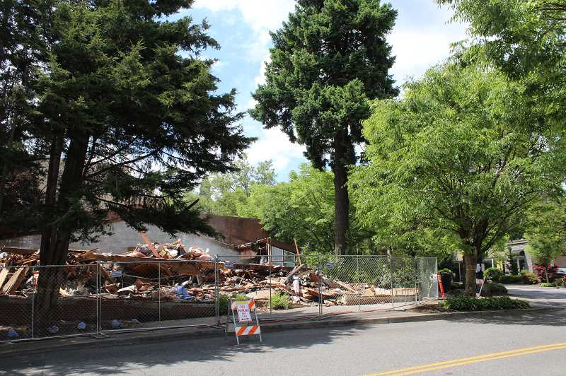 PMG PHOTO: PATRICK MALEE - Deconstruction of buildings near A Avenue and Third Street began Monday and is expected to last into mid-July as the City prepares for the eventual construction of a new City Hall.