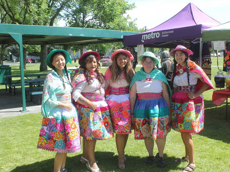 DESIREE BERGSTROM/MADRAS PIONEER - From left to right, Kelly Huang, Nancy poviz, Katherinne Perodi, Kim Schmith and Erika Olivera pose in traditional Peruvian costumes that would be worn to weddings and special events in Peru. Most of the costumes worn by the group are handstiched.