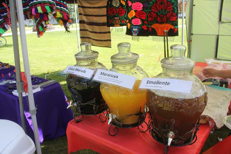 DESIREE BERGSTROM/MADRAS PIONEER - Several types of juices avaliable for tasting at the event, including emoliente, the national beverage of Peru. The Madras Key Club put on the cultural event, held at Sahalee Park.