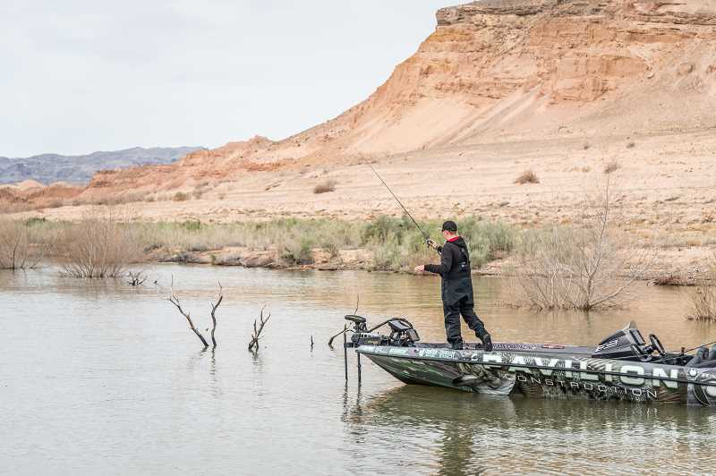 COURTESY PHOTO: COURTESY PHOTO: CHARLES WALDORF - Forest Grove teen and Banks High School graduate Lane Olson fishes from a boat during an FLW Series fishing event earlier this year at Lake Mead in Nevada.