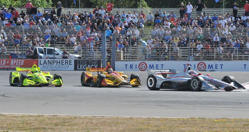 PMG PHOTO: JEFF ZURSCHMEIDE - Close racing at last year's event. Single-day and multi-day passes to the 2019 IndyCar race are on sale now at www.portlandgp.com.