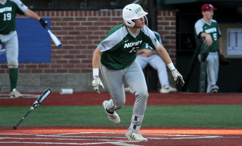 PMG PHOTO: MILES VANCE - West Linn's J.J. Hoover takes off after getting a hit in his North team's 13-10 loss to the South in the Oregon All-Star Series at Corvallis, Goss Stadium on Saturday, June 22.