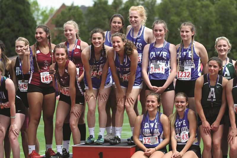 PMG PHOTO: JUSTIN MUCH - The state champion St. Paul relay team of Rachel Vela, Taysha Veeman, Destiny Smith and Isabelle Wyss, were part of the Buckaroos girls track and field program that ranked No. 1 in GPA in the state among 1A schools last year at 3.90.