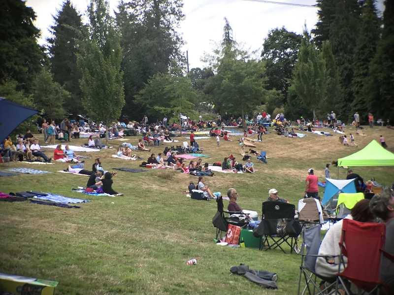 PMG FILE PHOTO: LESLIE PUGMIRE HOLE - Attendees at last year's West Linn Fourth of July celebration spread out on the grass at Willamette Park, enjoying food, drinks and live music before the fireworks show.