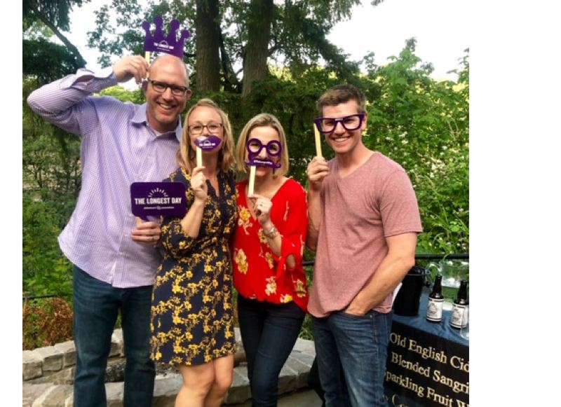 COURTESY PHOTOS - Dave Raff, Amanda Raff, Lindsay Paxton and Brandon Paxton stand by Queen Orchard's cider tasting during the June 21 event.