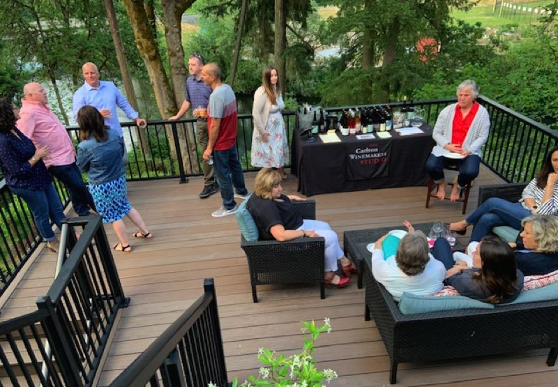 Solstice Sip guests join Whitney Govert from the Carlton Winemakers Studio on the back deck for their first of five wine tastings at the event.