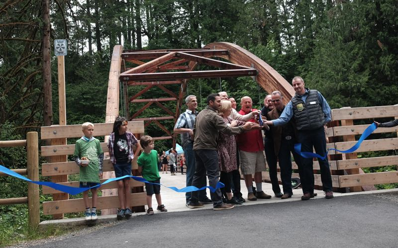 COURTESY PHOTOS - Representatives of Clackamas County, Happy Valley and Icon Construction participated in the ribbon-cutting ceremony.