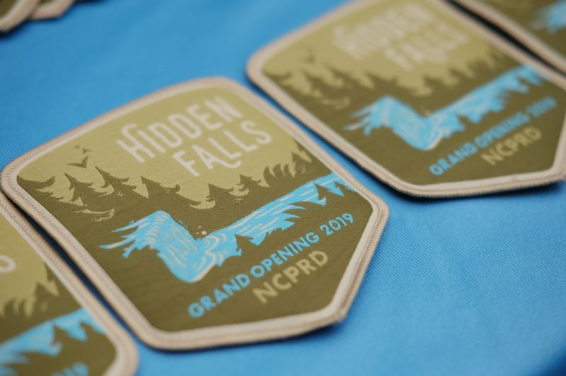 North Clackamas Parks & Recreation District made commemorative badges celebrating the opening of Hidden Falls Nature Park.