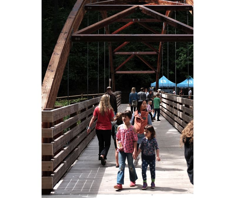 Families explore Hidden Falls on June 22 following the grand opening of the park.