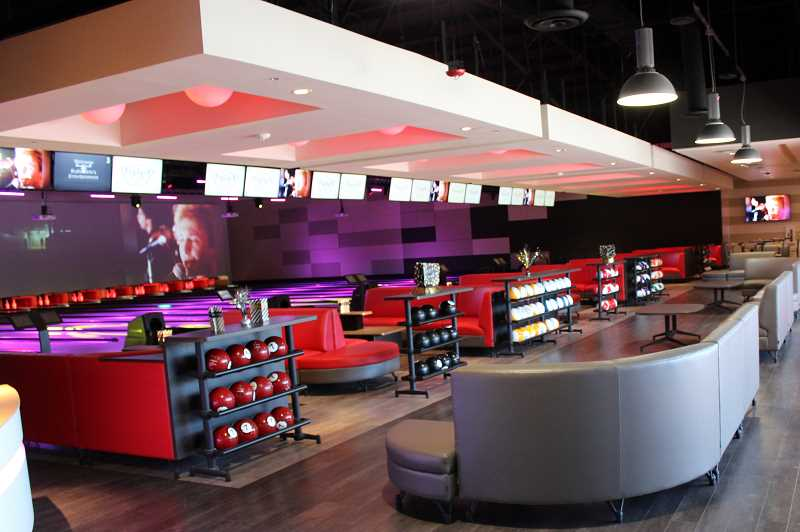 PMG PHOTOS: COREY BUCHANAN - The bowling center has 16 lanes with gameplay and video features.