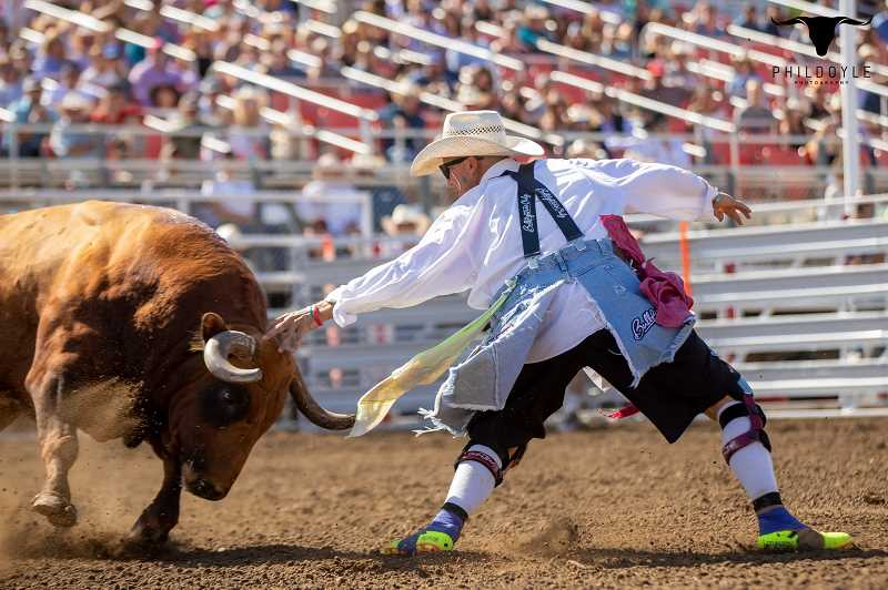 COURTESY PHOTO: ROSS HILL - Ross Hill engages in the risky business that comes with being a bullfighter.