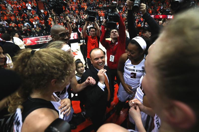 PMG FILE PHOTO: JAIME VALDEZ - Oregon State coach Scott Rueck celebrates with the Beavers after a 2017 victory over Stanford.