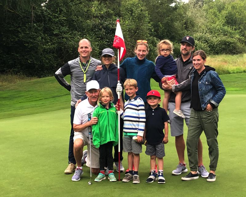 PMG PHOTO: MAVERICK PALLACK - Gay Davis (front row, left) is joined by his family during his day of marathon golf at Pumpkin Ridge Golf Club.