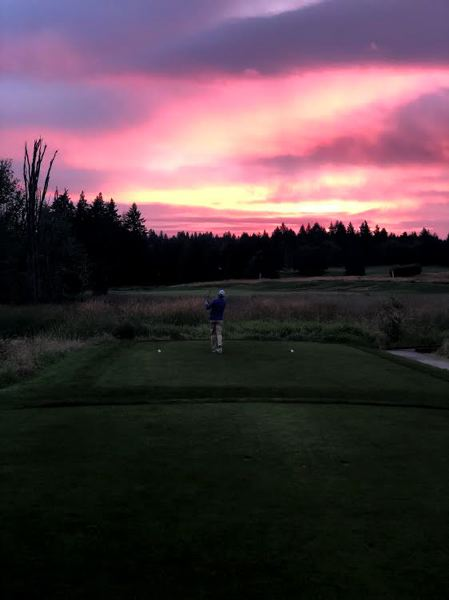 COURTESY PHOTO: CHILDREN'S CANCER ASSOCIATION - Pumpkin Ridge's Gay Davis tees off at 4:45 a.m. on one of the first holes of his 131-hole day at the club and to begin the final day of a three-day event that raised money for the Children's Cancer Association.