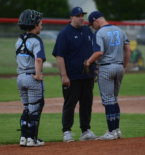 PMG PHOTO: DAVID BALL - Mt. Hood Gold manager Eric Fogle visits the mound for his squad that improved to 15-4 this summer.