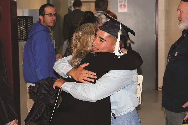 PMG PHOTO: JUSTIN MUCH - A total of 25 graduates took part in the William P. Lord High School commencement at MacLaren Youth Correctional Facility: 9 with GED certificates, 12 high school graduates; two attaining Associates degrees; one earning a bachelors degree from Portland State University.