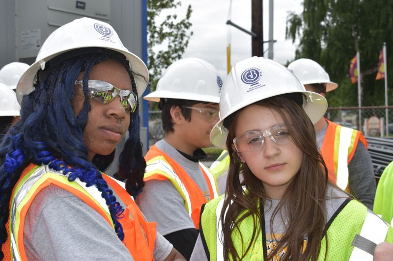 PMG PHOTO: TERESA CARSON - Lyle Pullom (left) and Samantha Schmitt try out their best problem-solving construction faces before touring the Gresham High School building site.