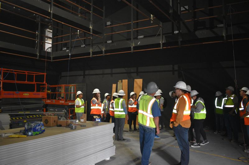 PMG PHOTO: TERESA CARSON - The design camp students tour the new black box theater being constructed at Gresham High.
