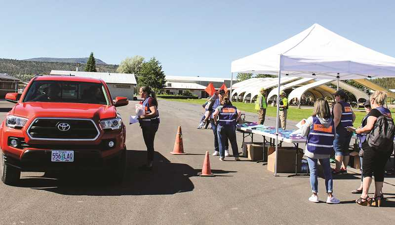 JASON CHANEY - Crook County Health Department staff and other community partners conducted the infectious disease exercise at Crook County Fairgrounds on June 4.