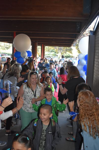 PMG PHOTO: TERESA CARSON - HIghland Elementary School has a tradition of a big welcome the first day of school. This year theyll also welcome their first Spanish dual immersion classroom.