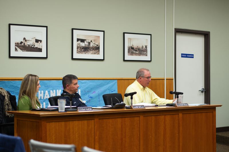 PMG PHOTO: ANNA DEL SAVIO - In his budget message to the Scappoose City Council and the citys Budget Committee, Scappoose City Manager Michael Sykes, right, outlined infrastructure work that the city will undertake to improve areas like sidewalks and wastewater management.