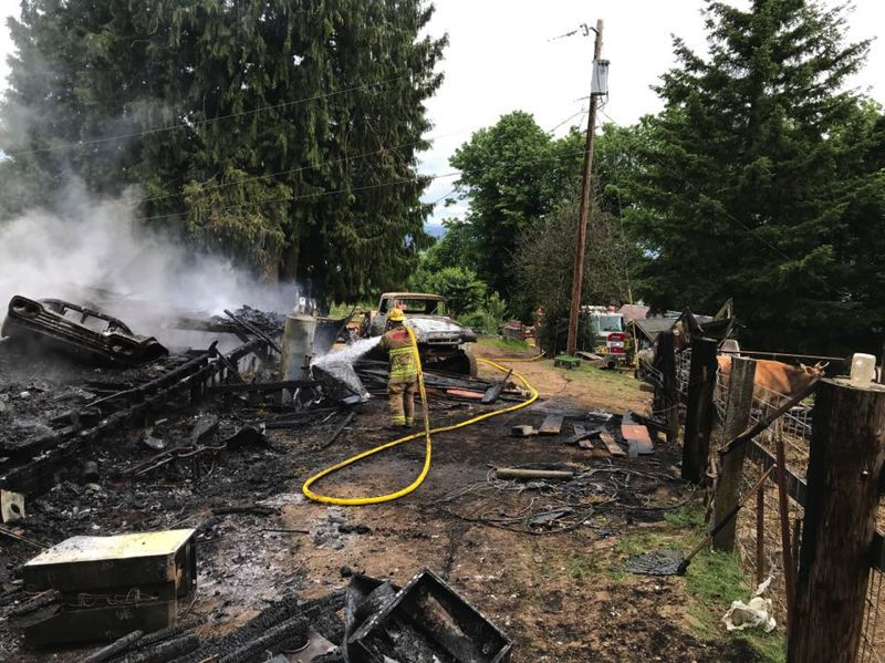 COURTESY PHOTO: COLUMBIA RIVER FIRE AND RESCUE  - Columbia River Fire and Rescue crews responded to a fire in Rainier on Monday, June 24. Fire crews believe the cause of the fire was electrical.