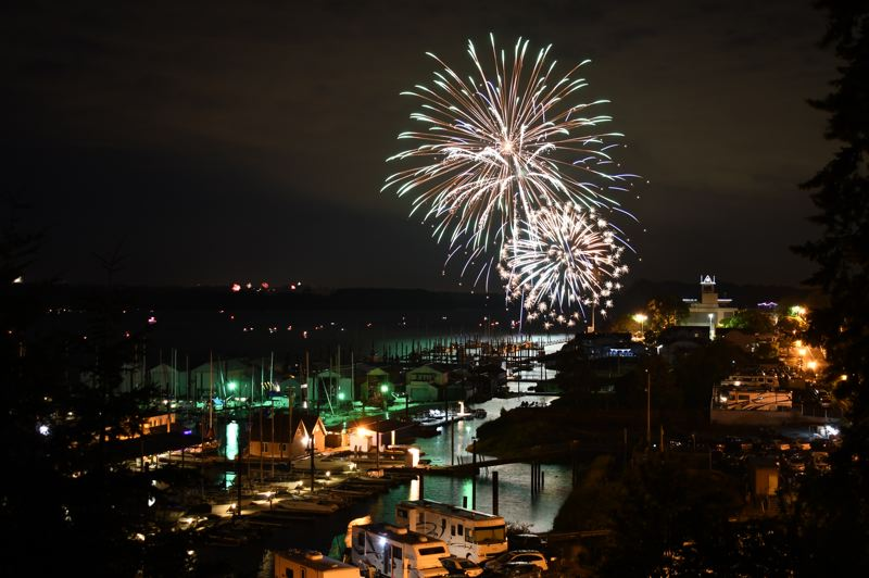 FILE PHOTO COURTESY OF THE CITY OF ST. HELENS - Fireworks illuminate the sky over the St. Helens waterfront on July 4, 2018. St. Helens will be hosting its annual fireworks display again next week on Thursday, July 4, at 10 p.m., with fireworks launching from Sand Island.
