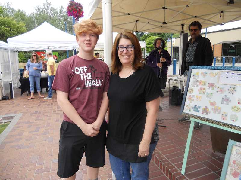 GAZETTE STAFF: SCOTT KEITH - Sherwood Saturday Market manager Erin Harrington and market assistant Dylan Robrecht keep things running smoothly during the markets four-month run.