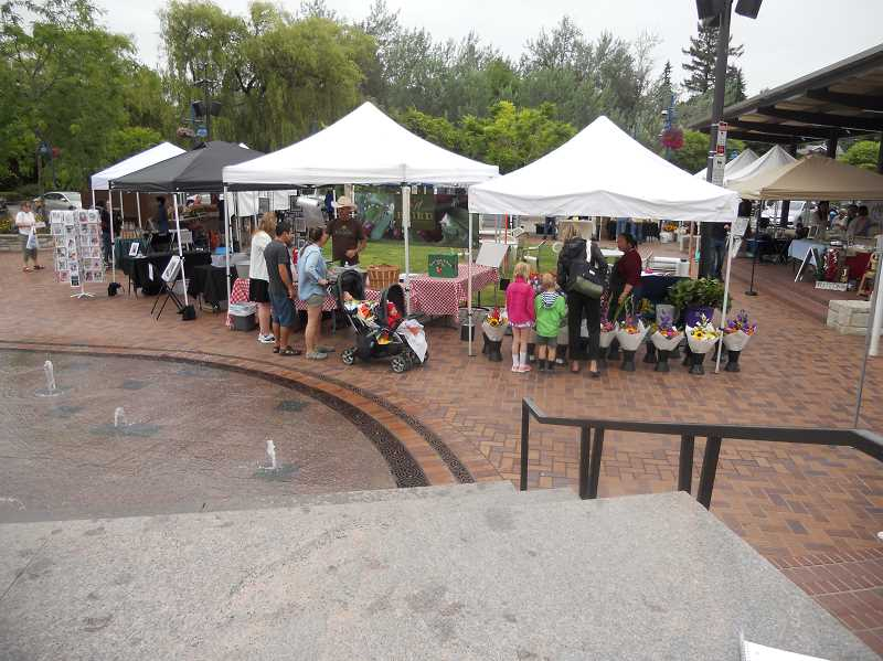 GAZETTE STAFF: SCOTT KEITH - Sherwood Saturday Market runs from May through September in Cannery Square in Old Town Sherwood.