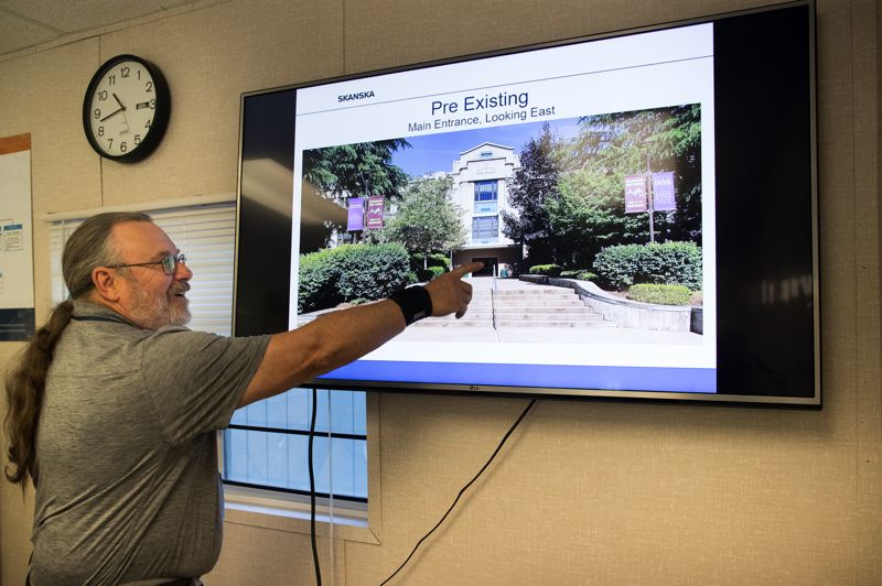 PMG PHOTO: JAIME VALDEZ - Steve Nicholas, a senior construction project manager with CBRE discusses how demolition of an original 1925 main academic building was demolished to make way for a new structure.