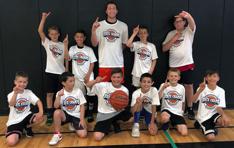 COURTESY PHOTO - Champions from the June 24-27 session of the Wildcat Hoop Camp's NCAA Division (grades 3-5) were the Oregon State Beavers and coach Nate Christensen.