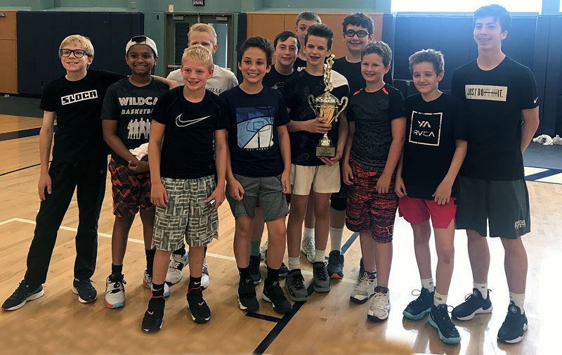 COURTESY PHOTO - Champions from the June 24-27 session of the Wildcat Hoop Camp's Olympic Division (grades 6-8) were team Nigeria and coach Finlay Dunn.