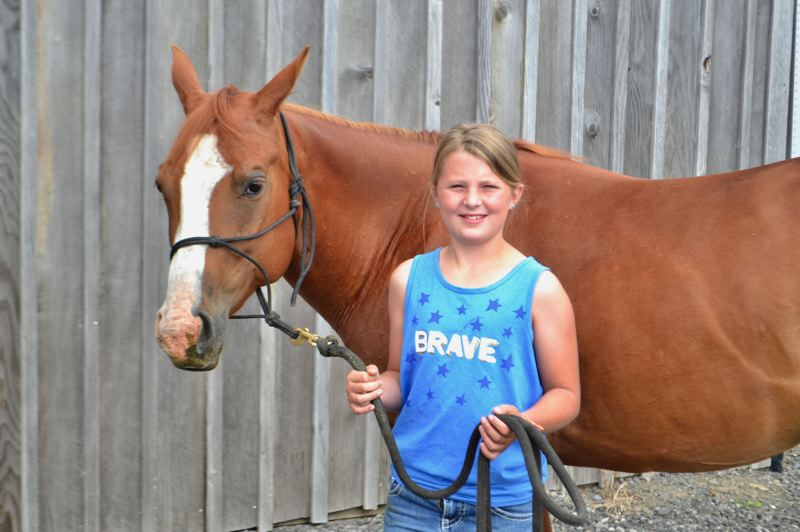 PMG PHOTO: BRITTANY ALLEN - Karington Mershon, 10, started riding rescue horse Mochi in March and will compete with her in the Lucky 7 Training Challenge this weekend in Ridgefield, Wash.