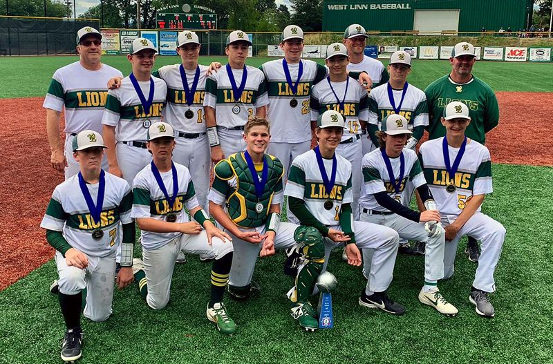 COURTESY PHOTO - The West Linn 14U Federal team poses with its trophy after winning the WLBA Babe Ruth tournament at West Linn High School last week.