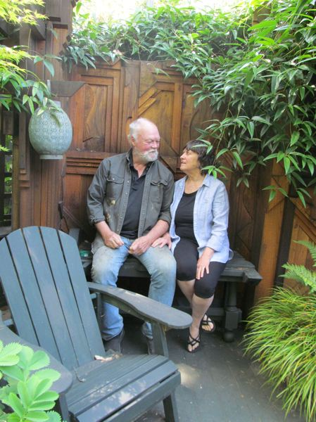 PHOTO BY ELLEN SPITALERI - George Green and his wife Jeri Hiser will open their garden and their personal studios to guests on the garden tour sponsored by the Friends of the Oak Lodge Library.