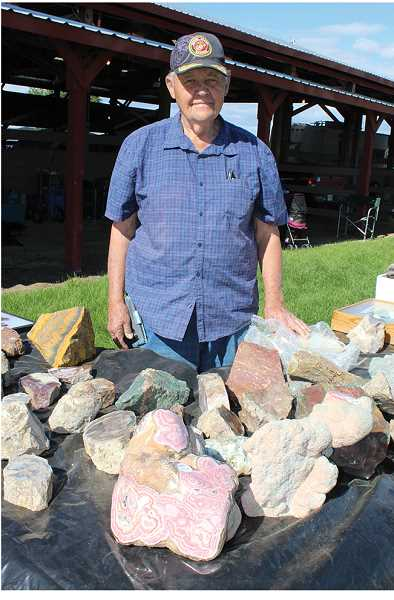 HOLLY M. GILL/MADRAS PIONEER - Buddy Bowers, of Phoenix, Arizona, has a large display of rhodochrosite and other stones.
