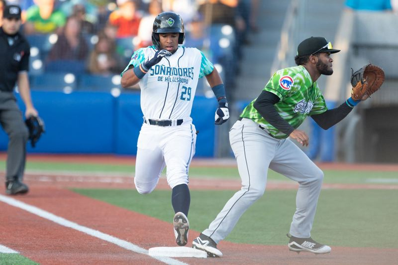 PMG PHOTO: CHRISTOPHER OERTELL - Eddie Hernandez gets to first base for the Hillsboro Hops in their Friday night victory at home against the Eugene Emeralds.