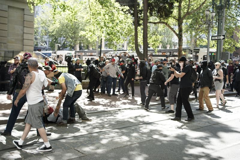 PMG PHOTO: KIT MACAVOY - Portland Police declared a civil disturbance on Saturday, June 29, after brawlers bloodied the street near Pioneer Courthouse Square.