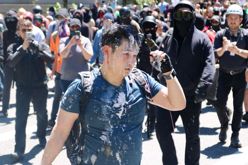 PMG PHOTO: ZANE SPARLING  - Andy Ngo, a famous conservative on Twitter, was attacked by several people while live-streaming a political march and Antifa rally in Portland on Saturday, June 29.