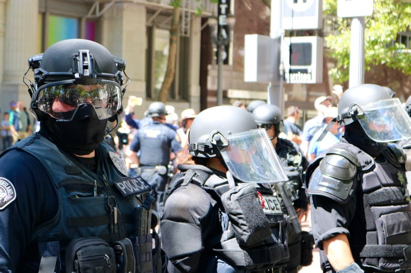 PMG PHOTO: ZANE SPARLING - Portland Police outfitted in riot gear blockaded streets to prevent unpermitted marchers from clashing during a rally on Saturday, June 29.
