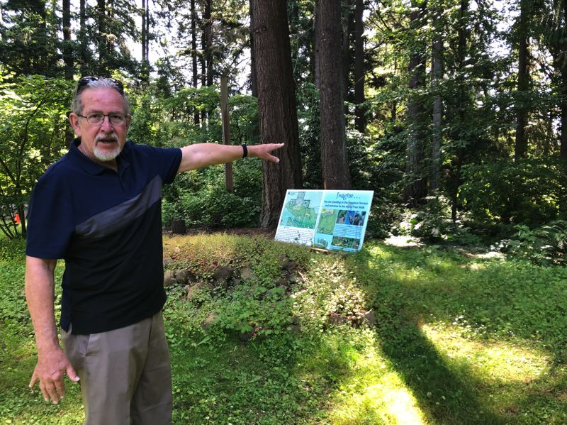 PMG PHOTO: STEPHANIE BASALYGA - David Porter, executive director of the nonprofit Leach Garden Friends group, points to the future location of an aerial tree walk.