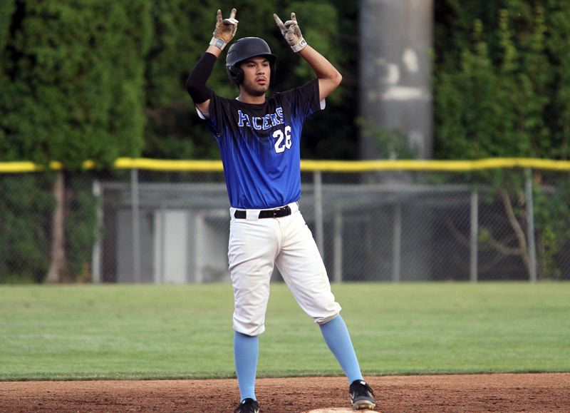 PMG PHOTO: MILES VANCE - Lakeridge's Colin Hardy celebrates a fifth-inning double during his team's 9-7 win over Jesuit in the 2019 Firecracker Classic at Lakeridge High School on Sunday, June 30.