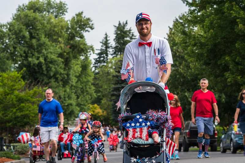 COURTESY OF KING CITY COMMUNITY FOUNDATION - Micah Paulsen marches in last years Fourth of July parade.