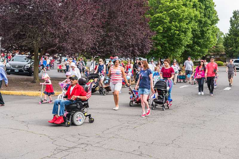 COURTESY OF KING CITY COMMUNITY FOUNDATION - The annual Fourth of July Parade draws dozens of spectators from around the city.