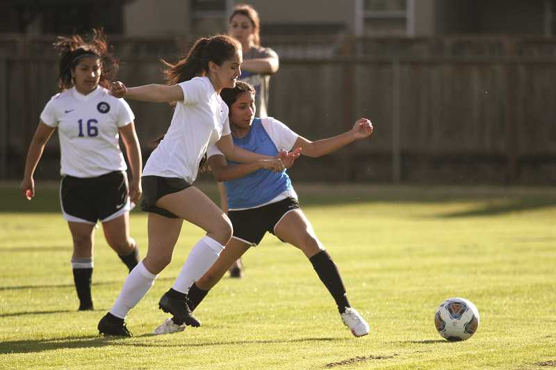 PMG PHOTO: PHIL HAWKINS - Rather than participate in summer league this year, the Woodburn girls soccer team will practice close to home and hold several blue vs. white full scrimmages at Woodburn High School over the summer.