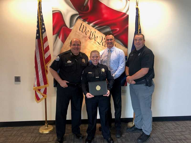 COURTESY OF CITY OF WOODBURN - Left to right, Woodburn Police Chief Jim Ferraris with recent leadership program graduate Sgt. Colleen Altabef, Deputy Chief Marty Pilcher and previous program graduate Lt Jason Millican.